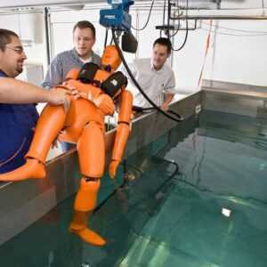 A human replica test dummy is lowered into the test pool ...